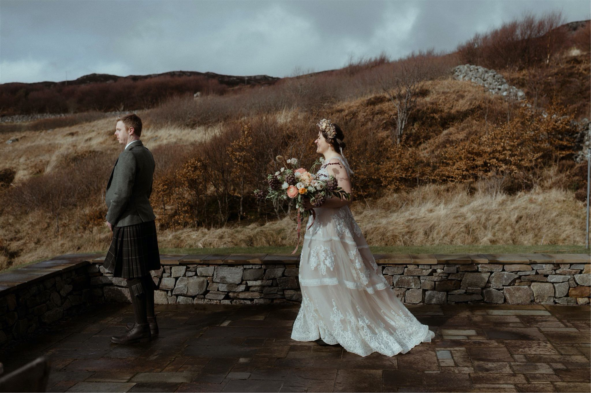 First look between bride and groom at their elopement wedding in Assynt, Scotland