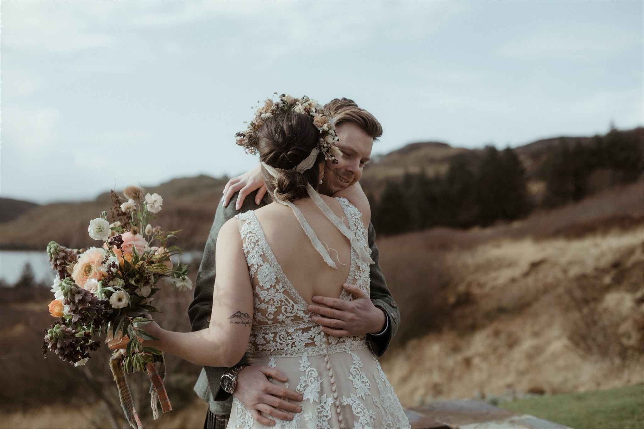 Bride and groom hug during their elopement wedding in Assynt, Scotland