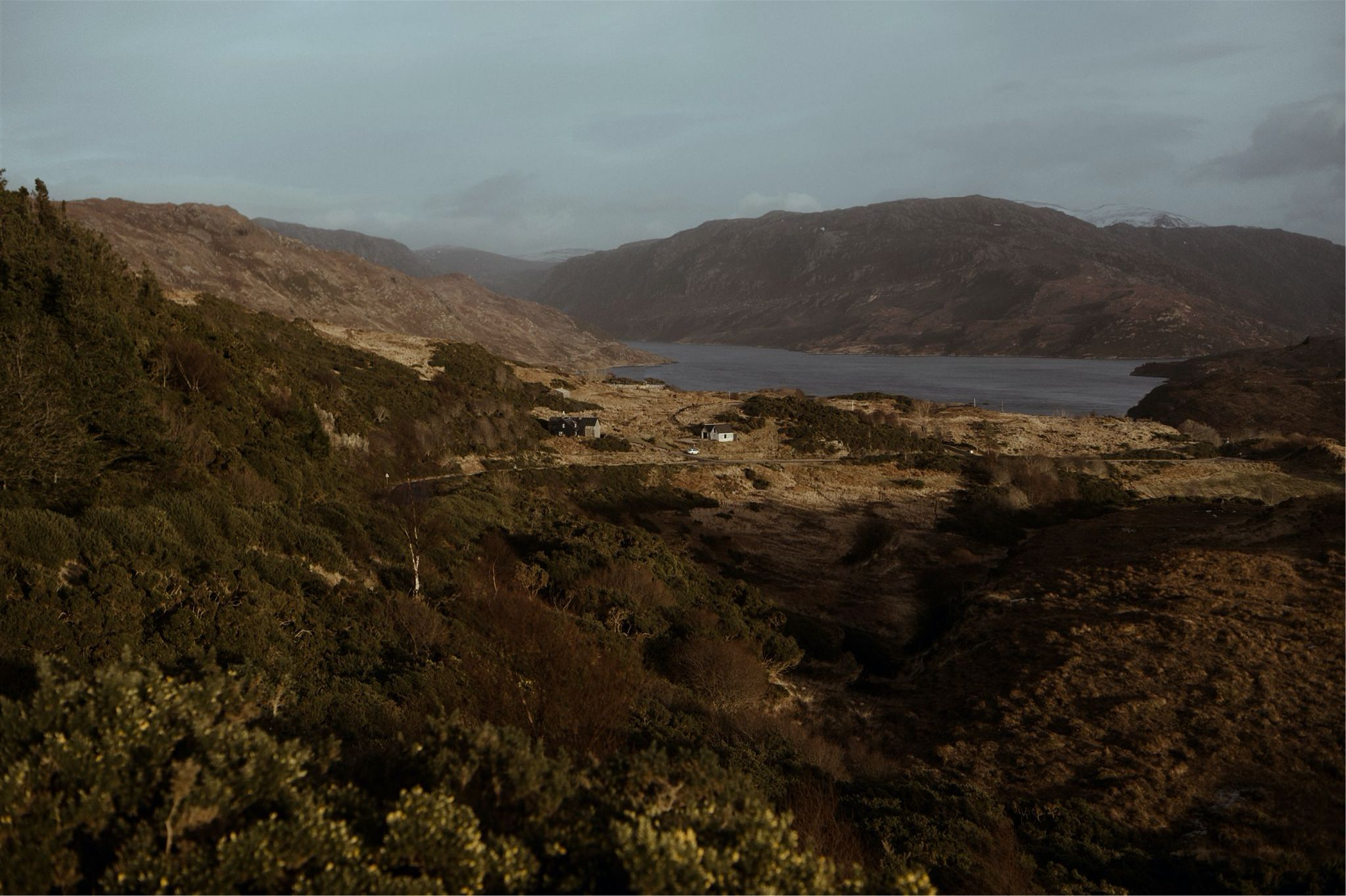 View of hills, cottage and loch in Assynt, Scotland