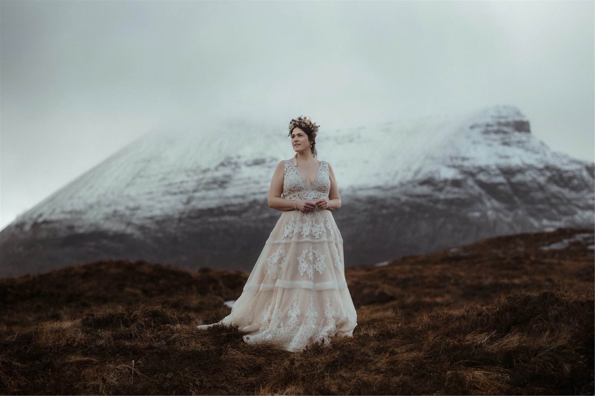 Bride with flower crown and mountain backdrop during a mountain elopement wedding in Assynt, Scotland