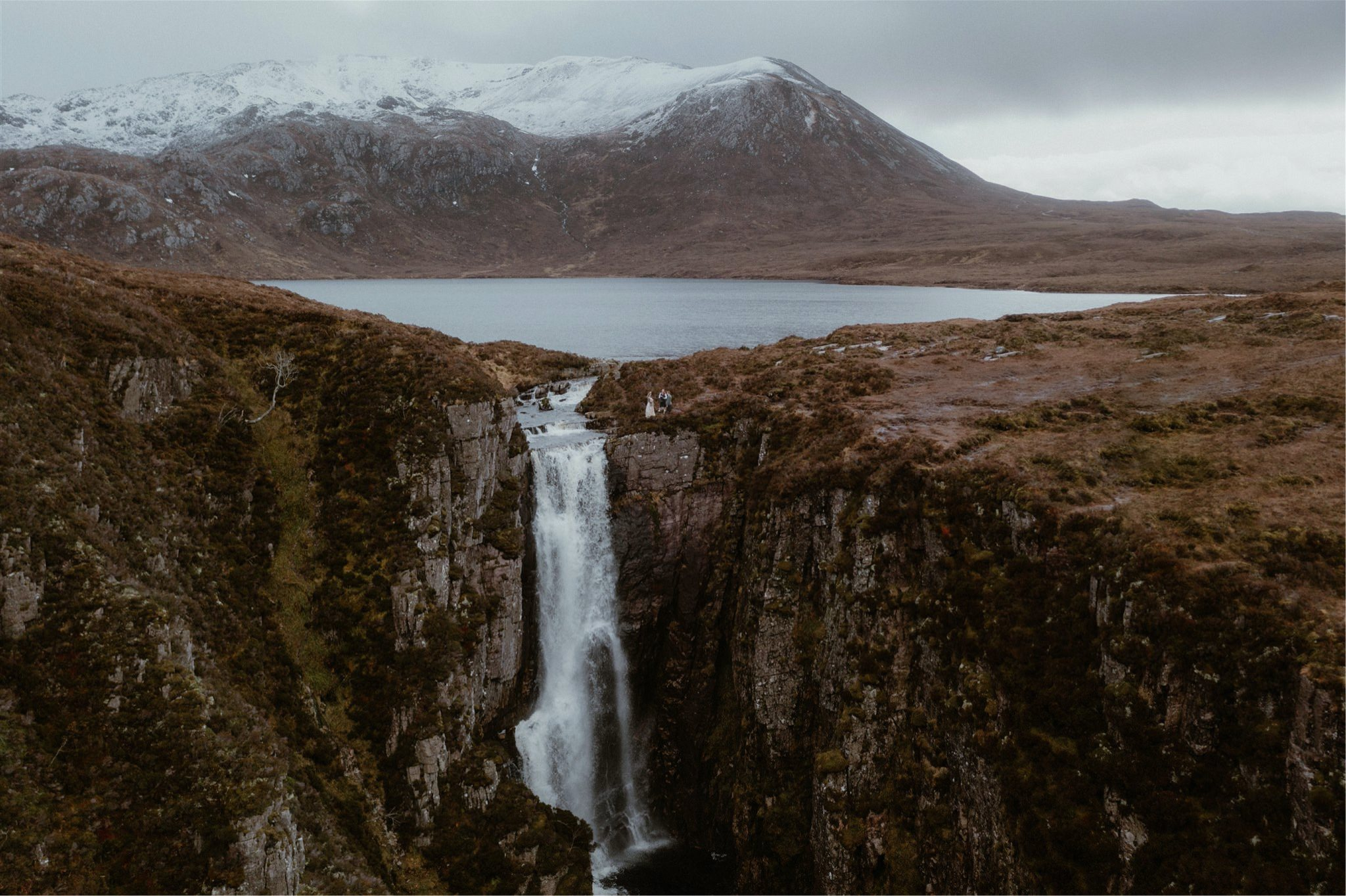 Scotland elopement wedding ceremony taking place by a waterfall in Assynt
