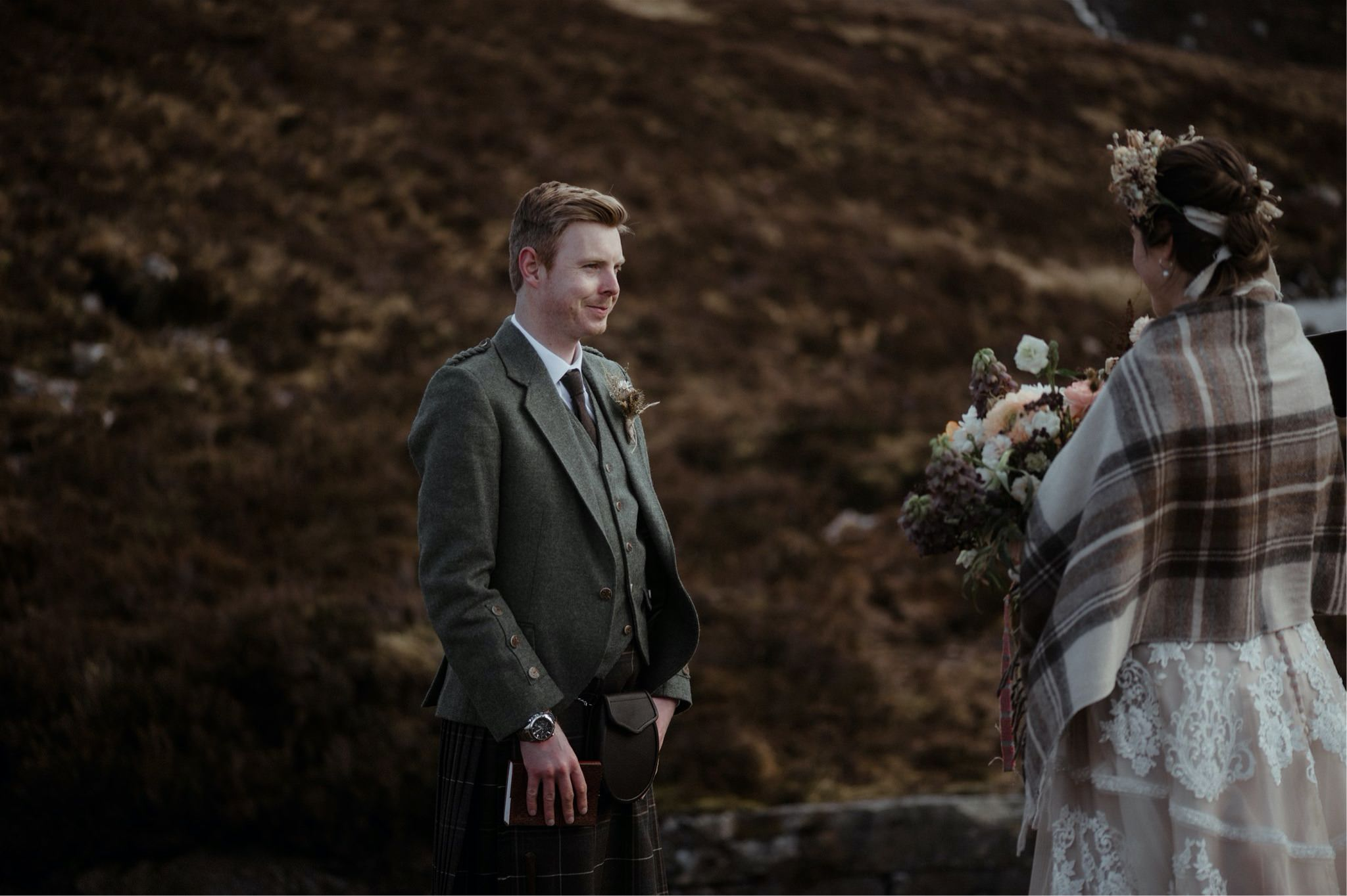 Groom looking at bride lovingly during a Scotland elopement wedding in Assynt