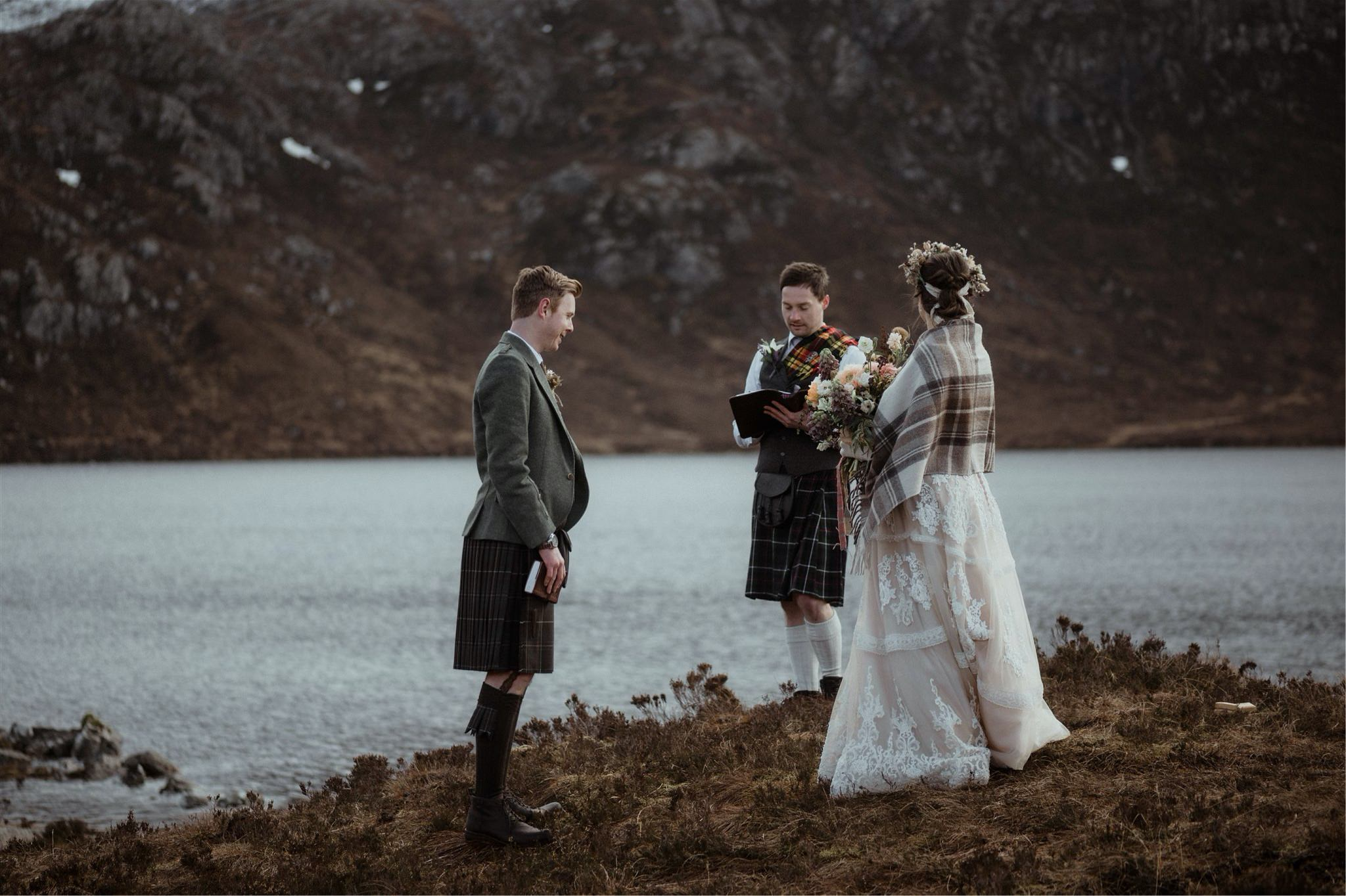 Scotland elopement wedding ceremony taking place in Assynt with mountain and waterfall backdrop
