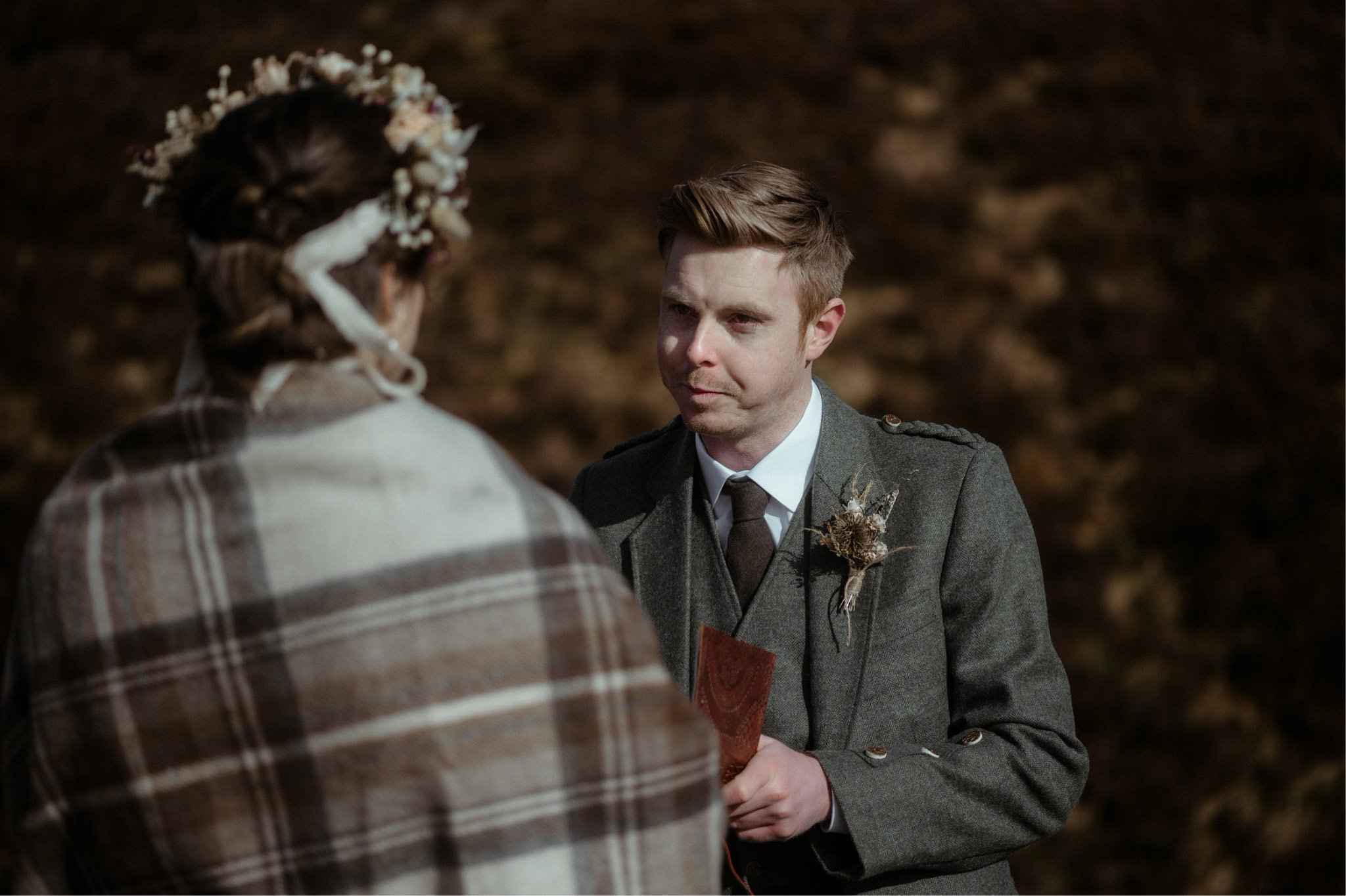 Groom reading vows to his bride during an elopement wedding in Assynt, Scotland