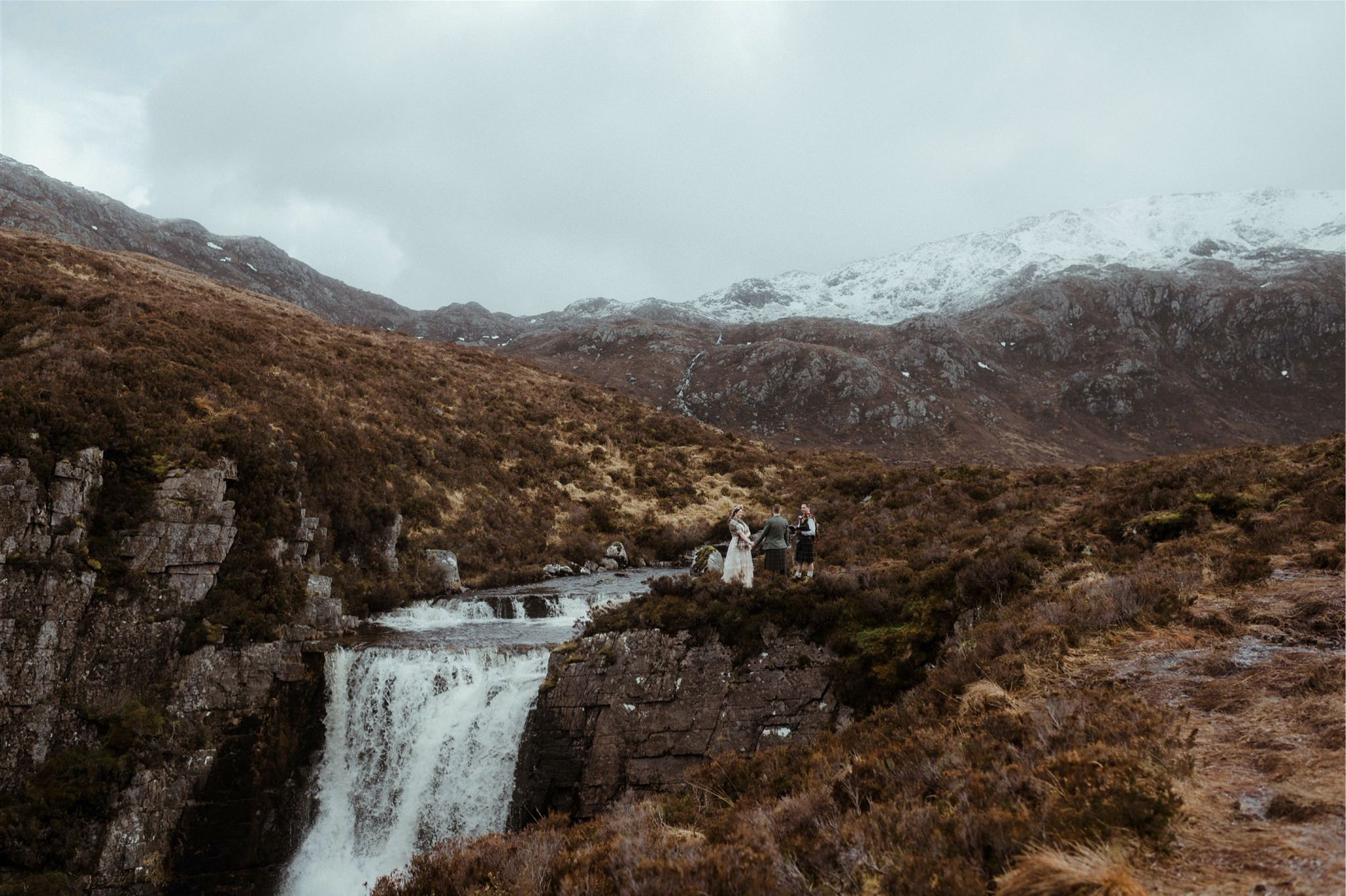 Outdoor elopement wedding ceremony taking place in Assynt, Scotland