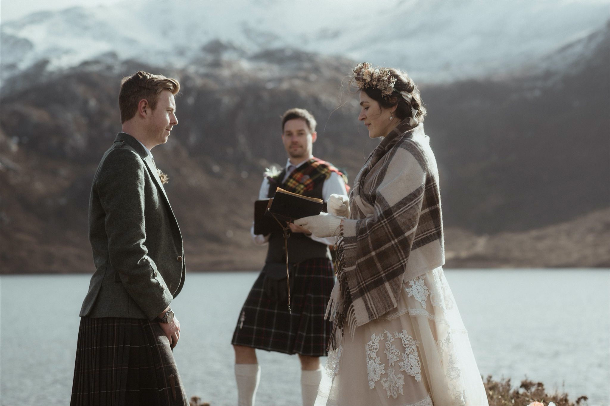 Bride reading vows to her groom during an elopement wedding in Assynt, Scotland