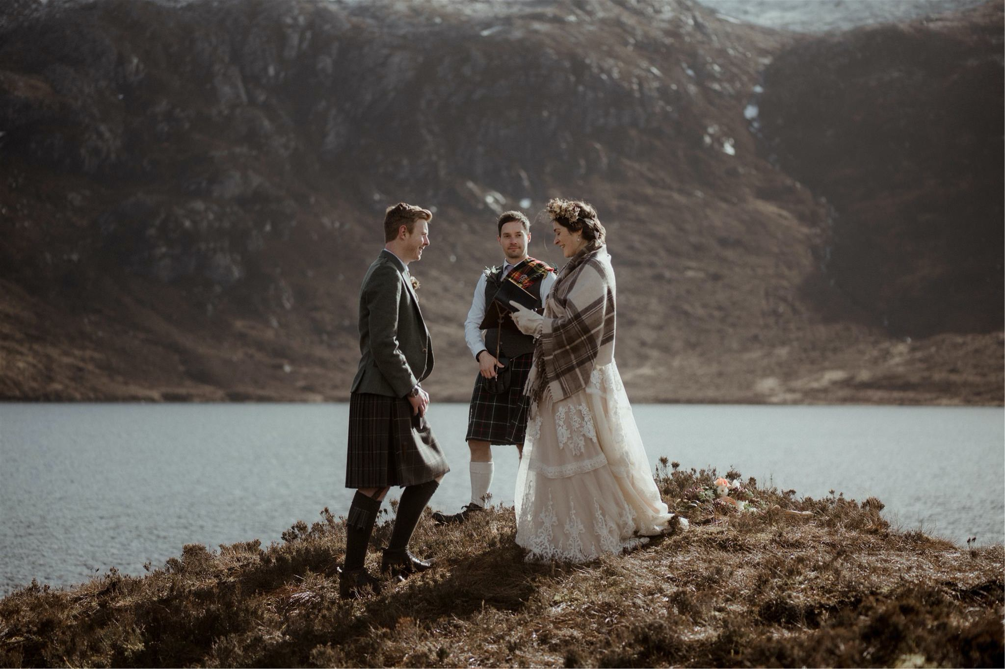 Bride reading vows to her groom during a Scottish elopement wedding in Assynt