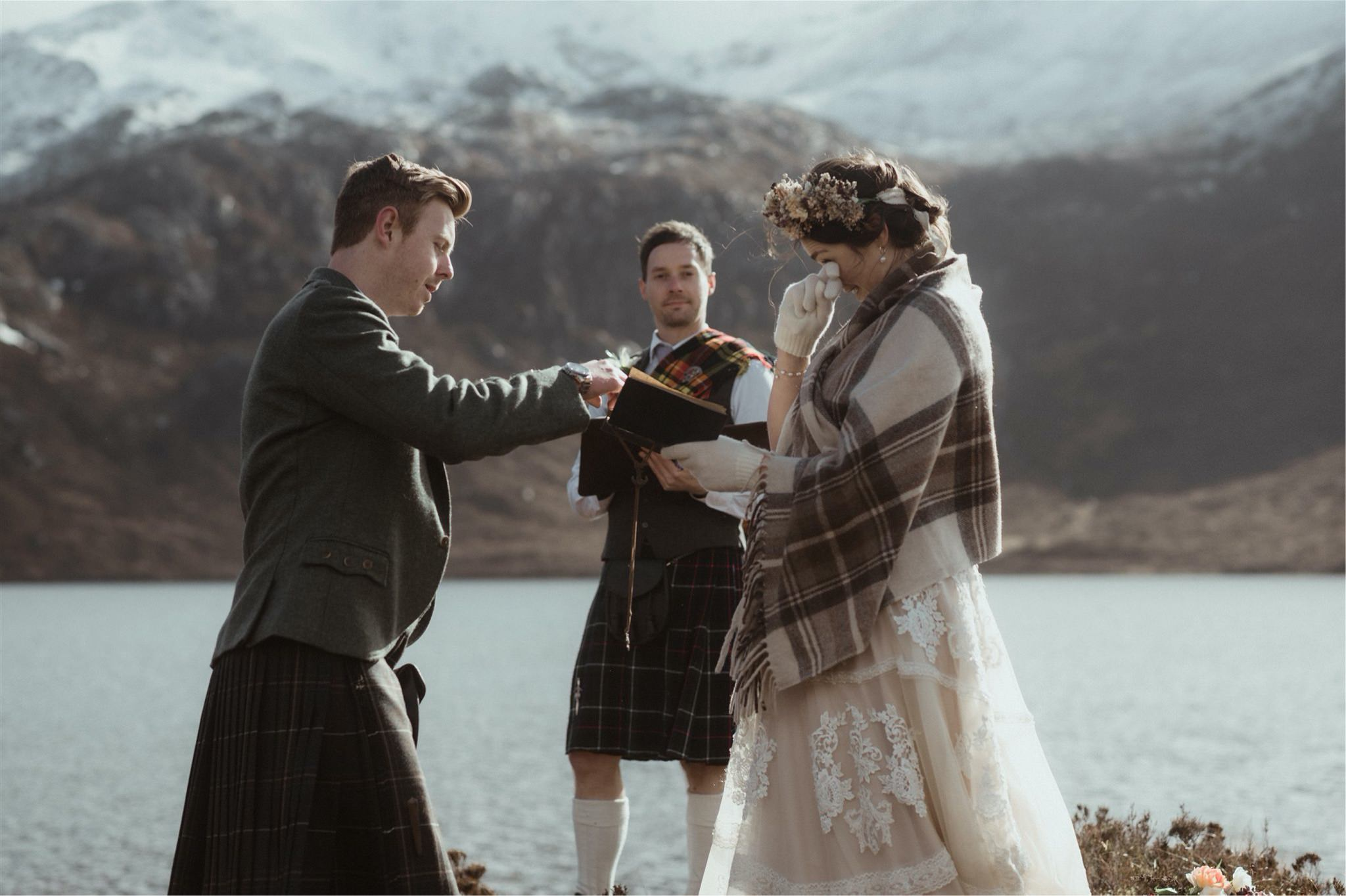 Bride getting emotional during an Scotland elopement ceremony in Assynt