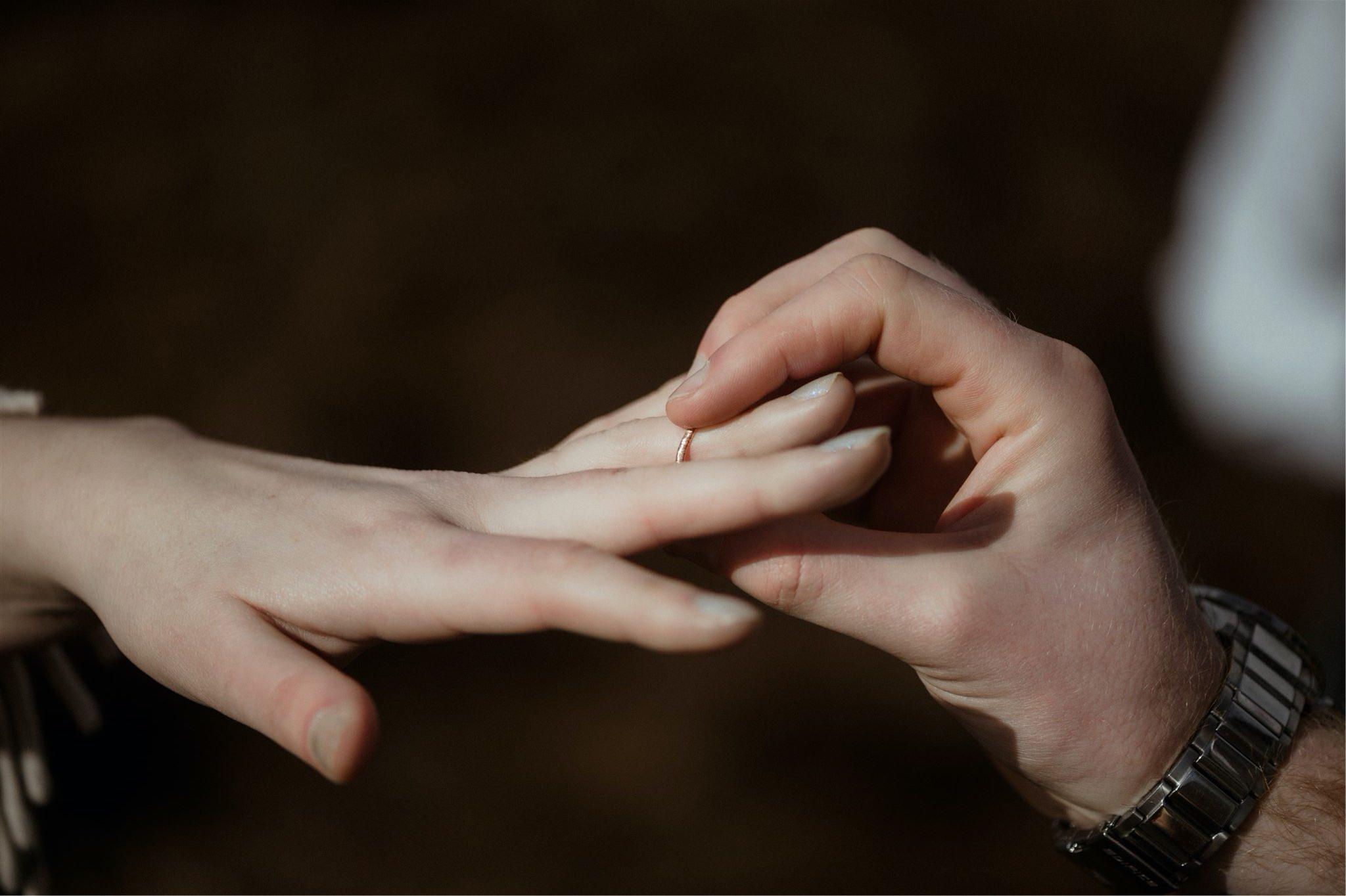 Detail shot of ring exchange during a Scottish elopement wedding in Assynt