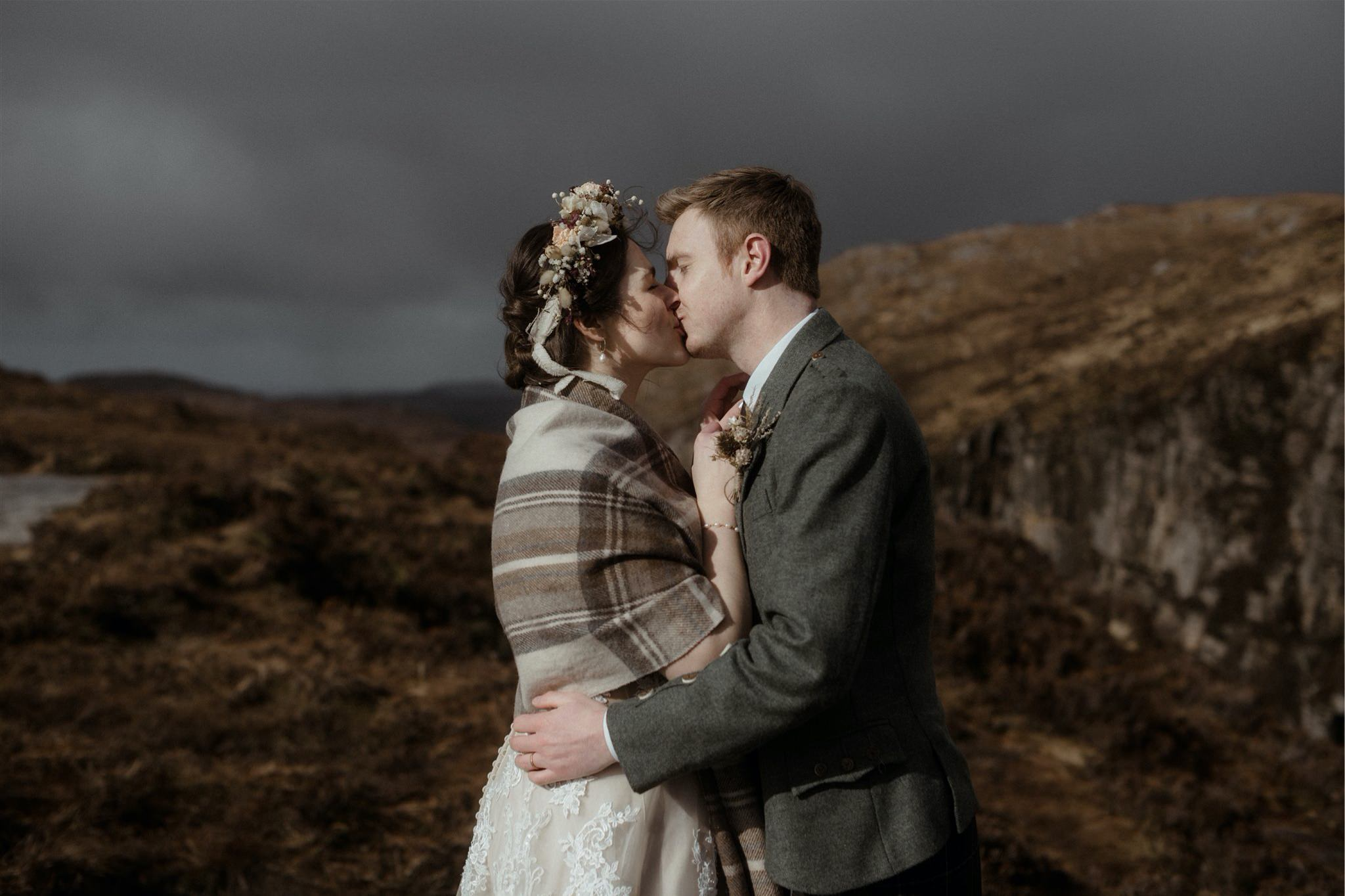 Bride and groom kiss at their Assynt elopement in Scotland