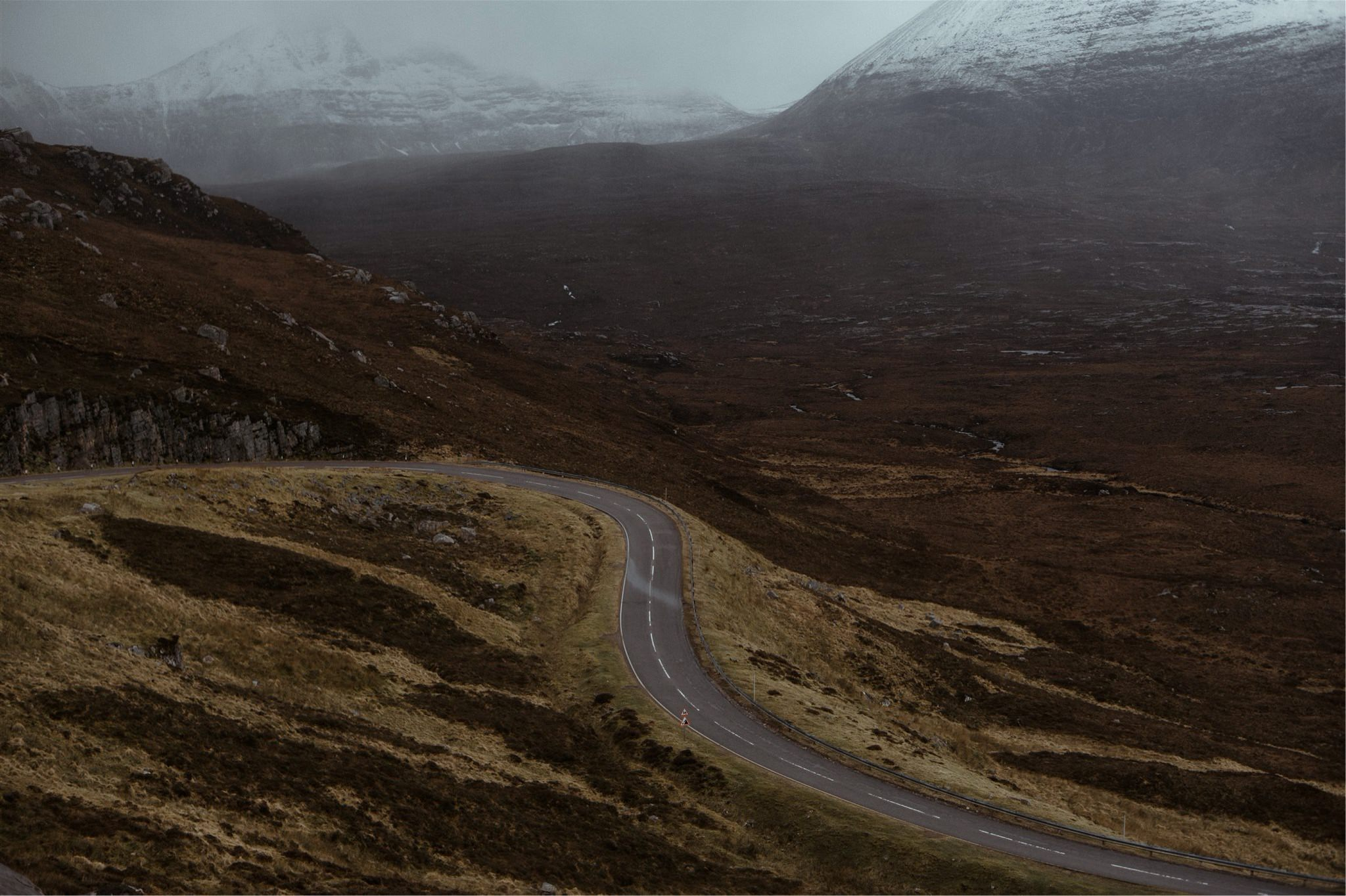 Road leading through the mountains on the NC500 Route in Assynt, Scotland