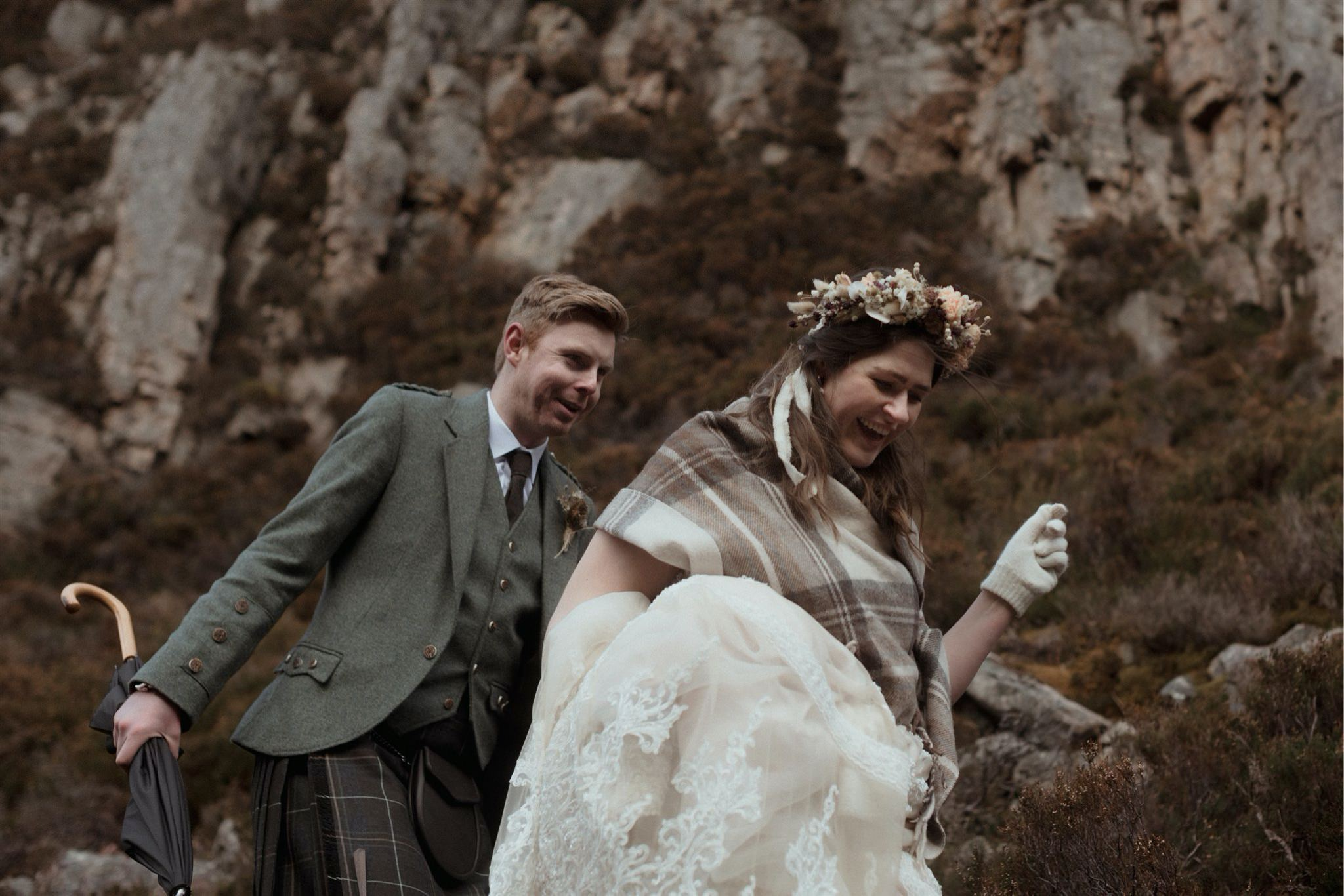 Bride and groom walking through a gorge after their elopement in Assynt, Scotland