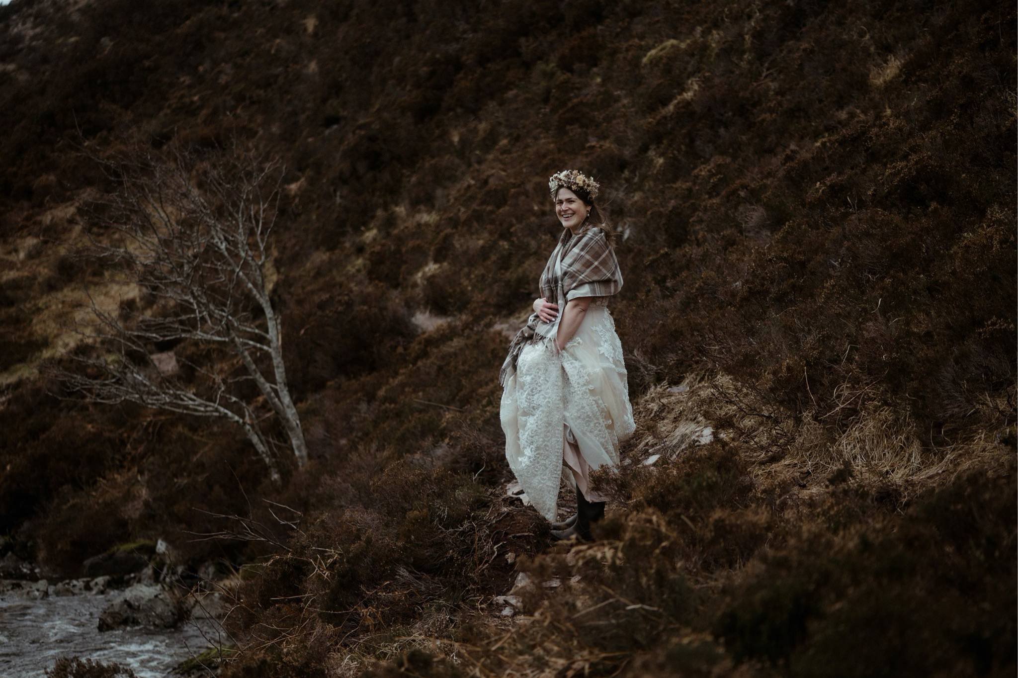 Bride standing in a gorge in Assynt after an elopement wedding in Scotland
