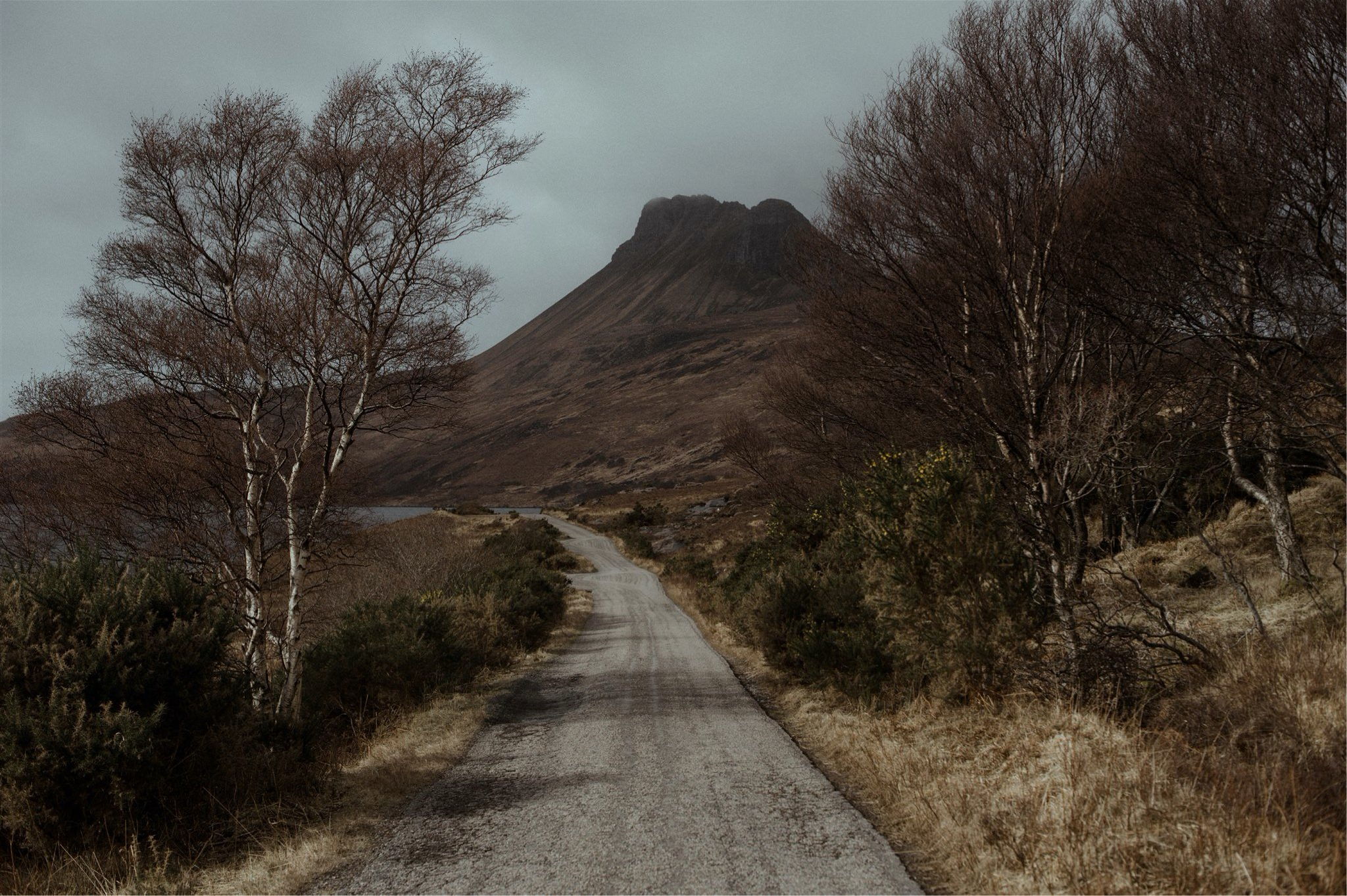 Landscape shot of a road leading towards a mountain in Assynt, Scotland