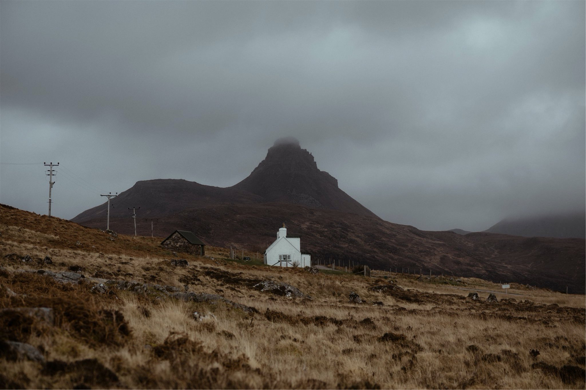 Landscape shot of a cottage and mountain in Assynt, Scotland