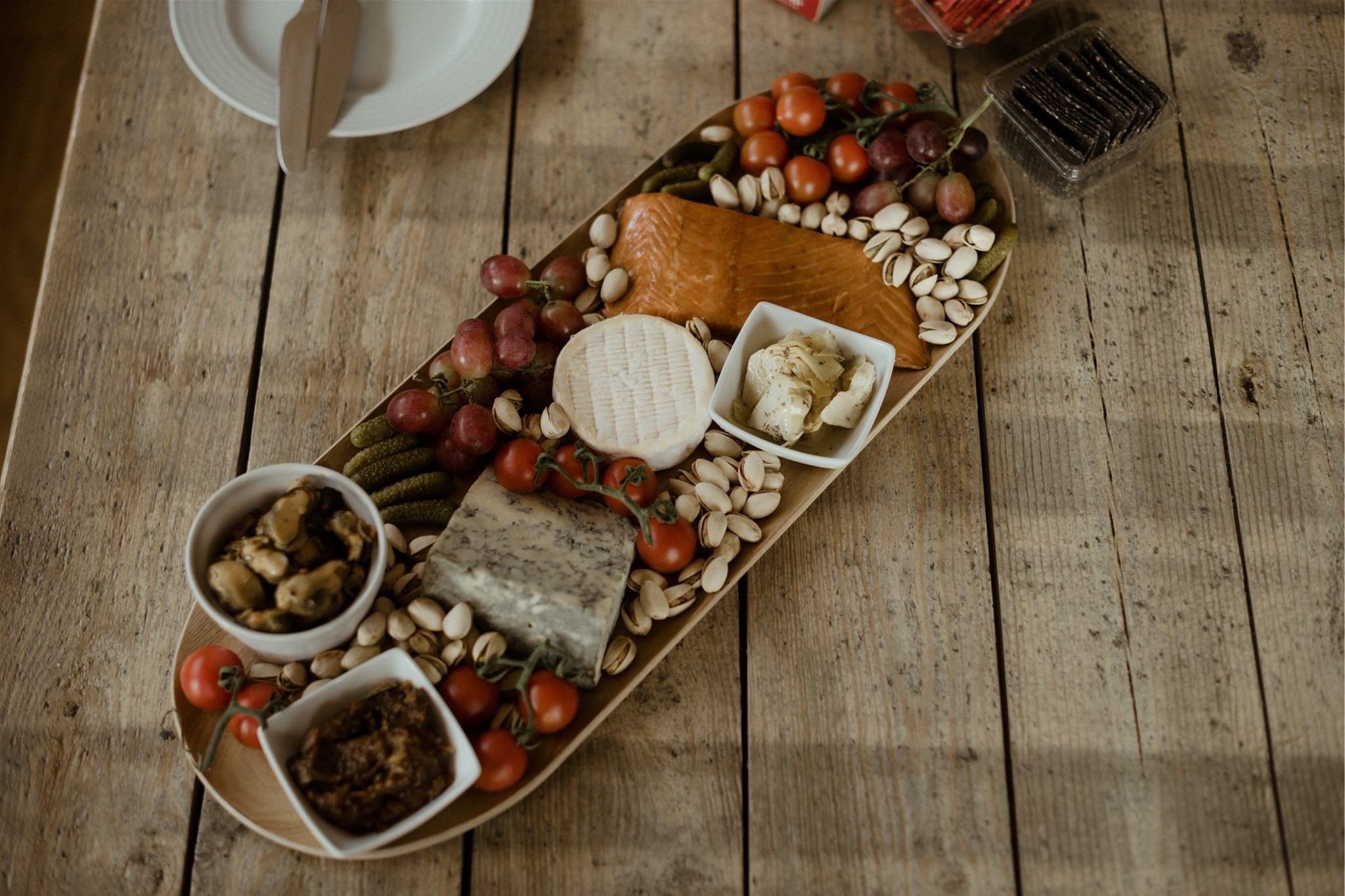 Plate of snacks on a wooden table
