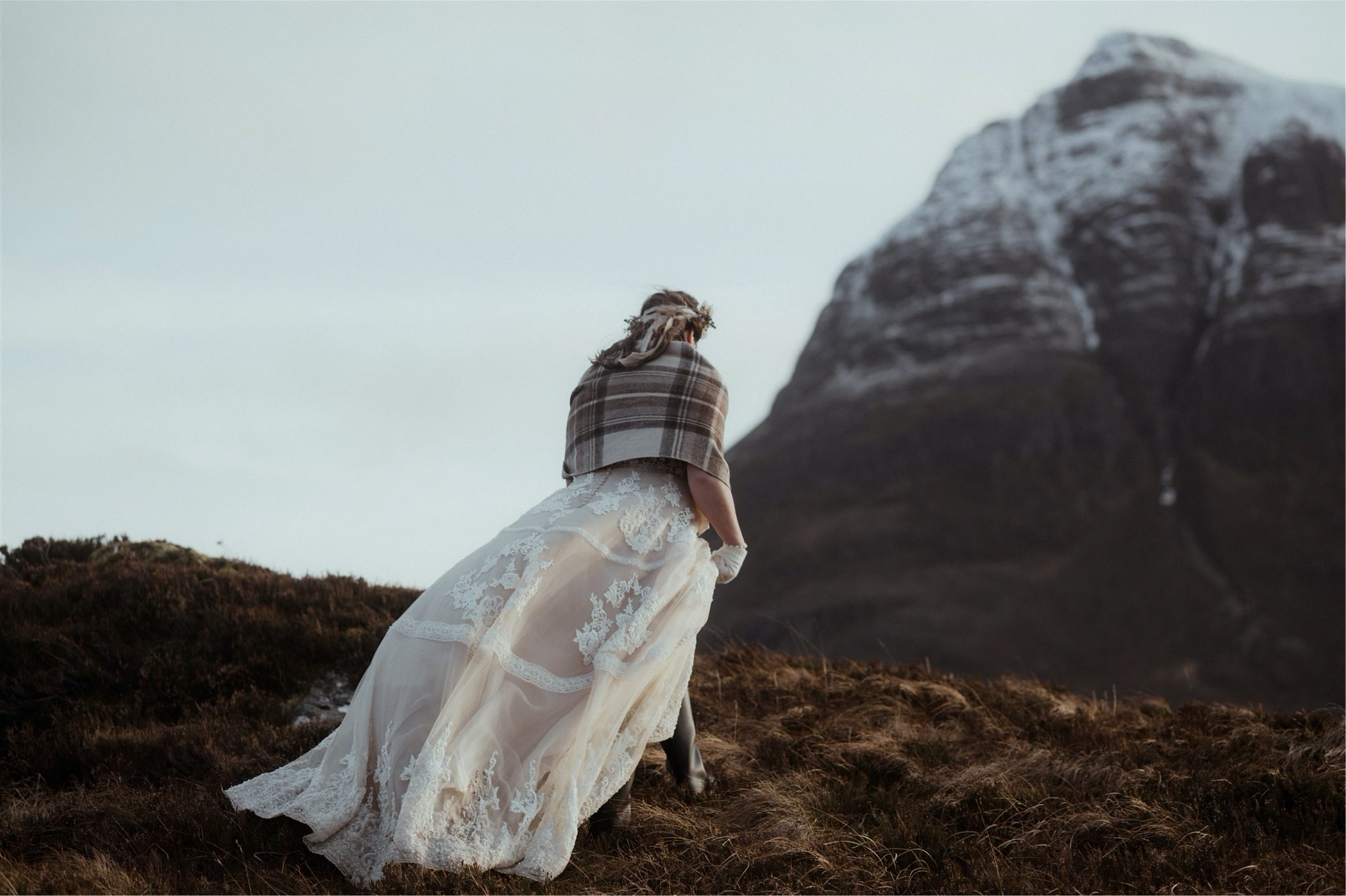 Bride walking in the mountains during a Scottish elopement wedding in Assynt