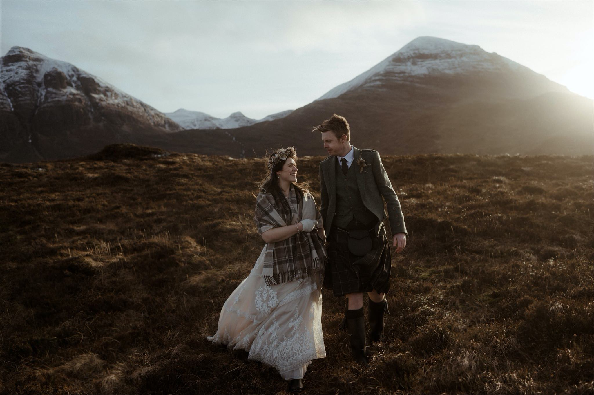 Bride and groom walking in the mountains after their elopement in Scotland