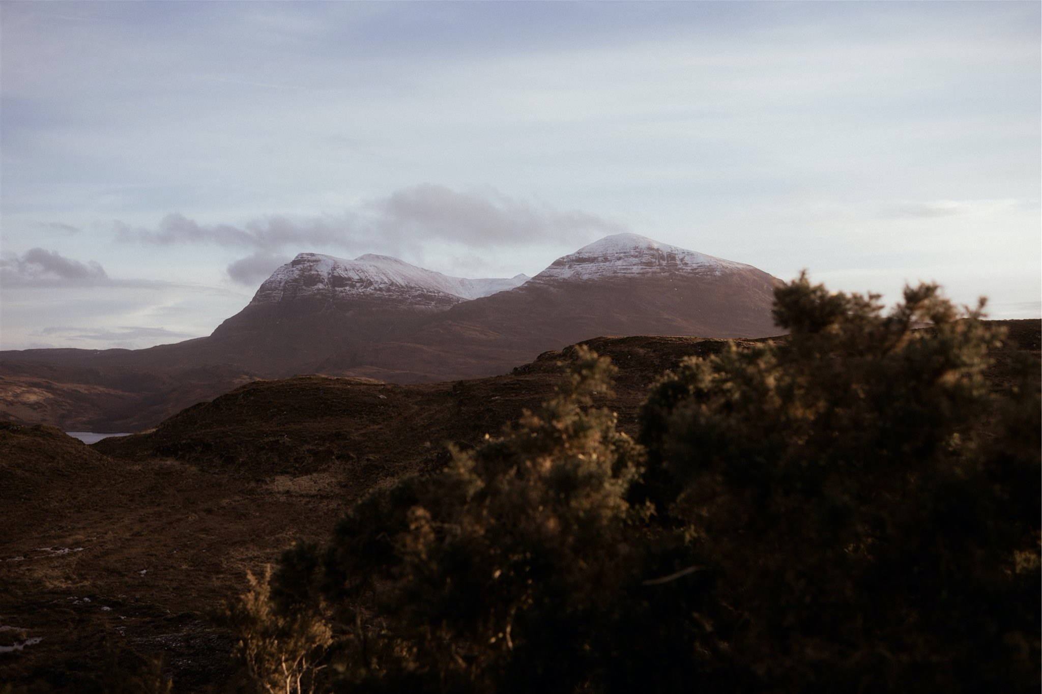 Landscape shots of snow-covered mountains in Assynt, Scotland