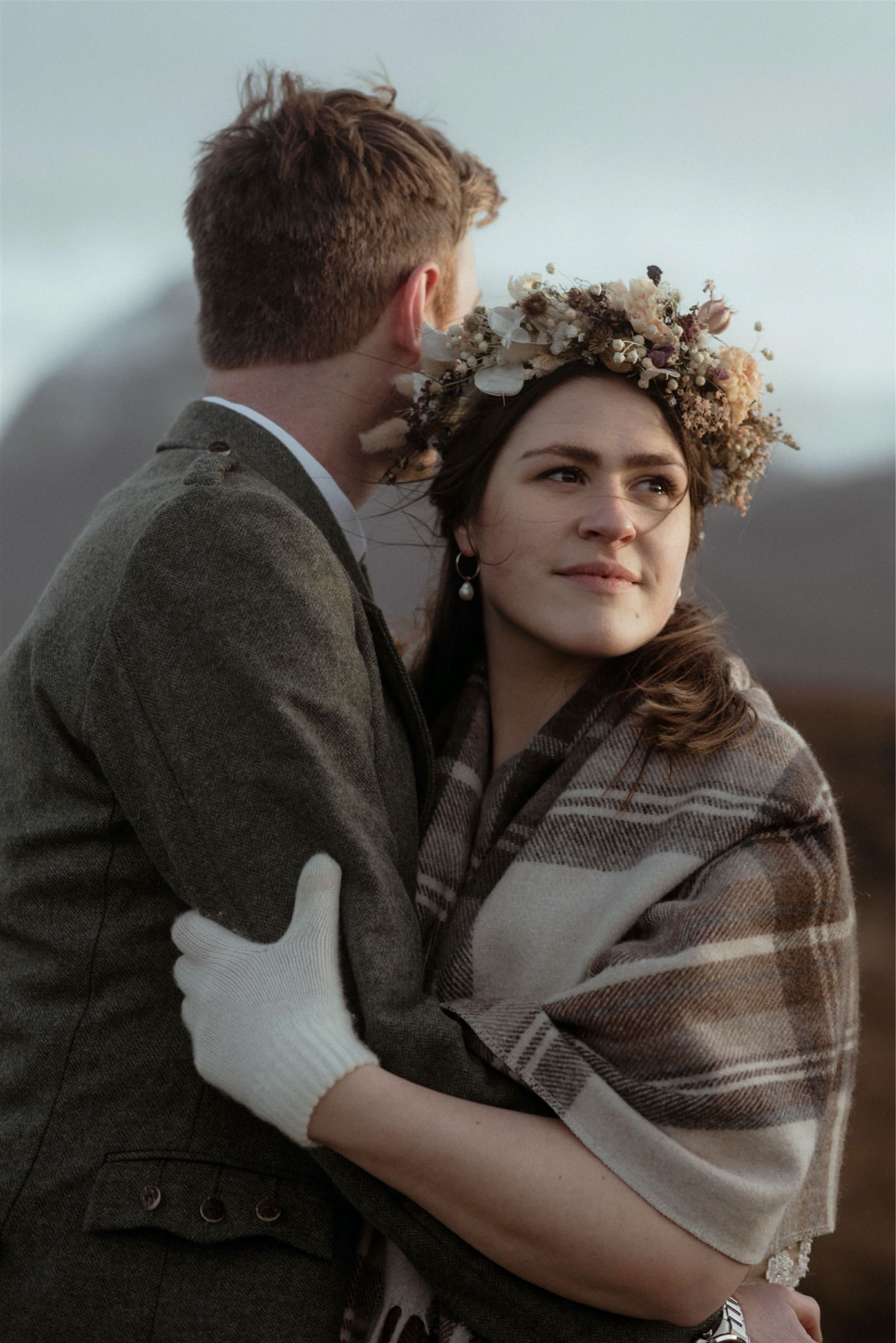 Bride and groom embrace in the mountains after their Scottish elopement wedding in Assynt