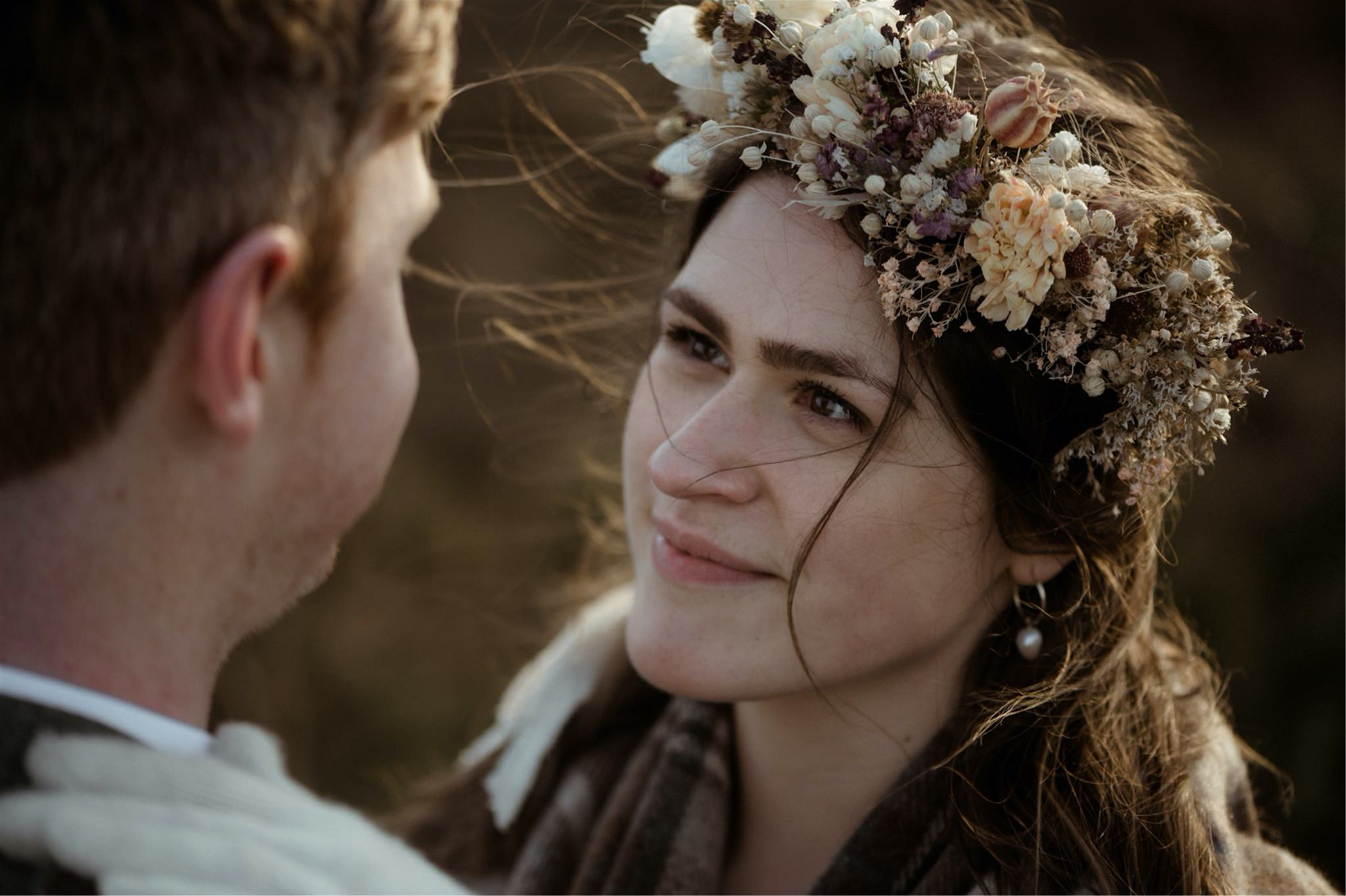 Bride and groom embrace in the mountains after deciding to elope in Scotland