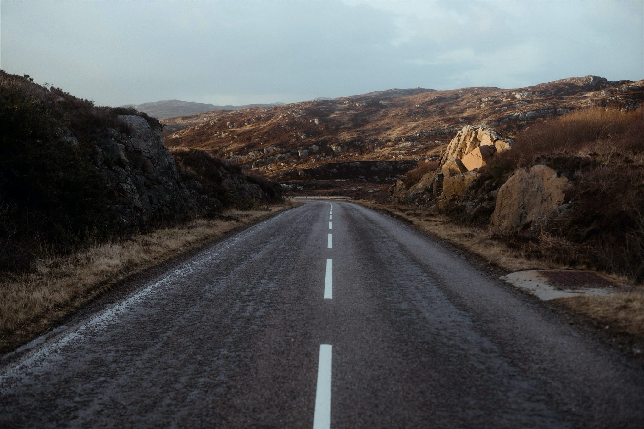 Road through the mountains in Assynt - on the North Coast 500