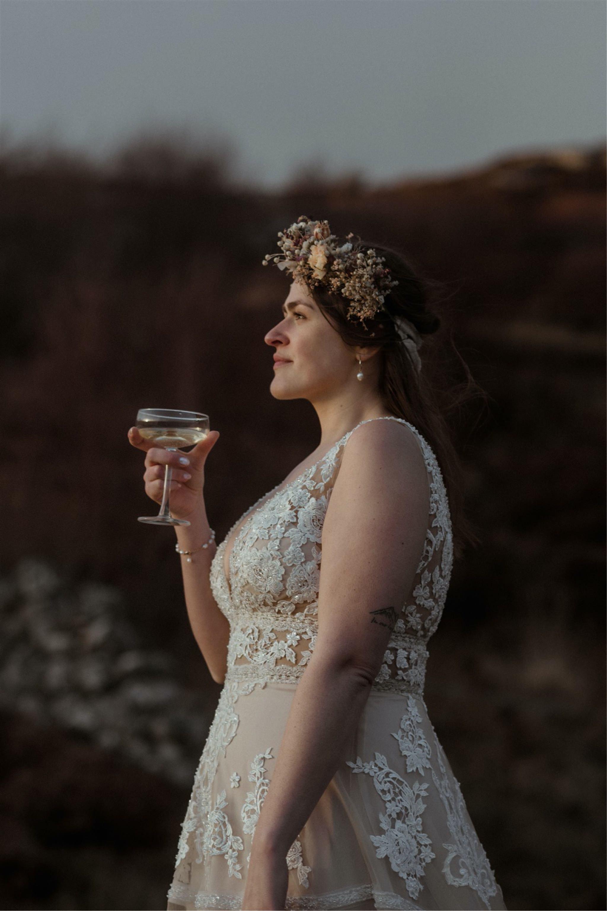 Bride drinking Champagne after a Scotland elopement wedding