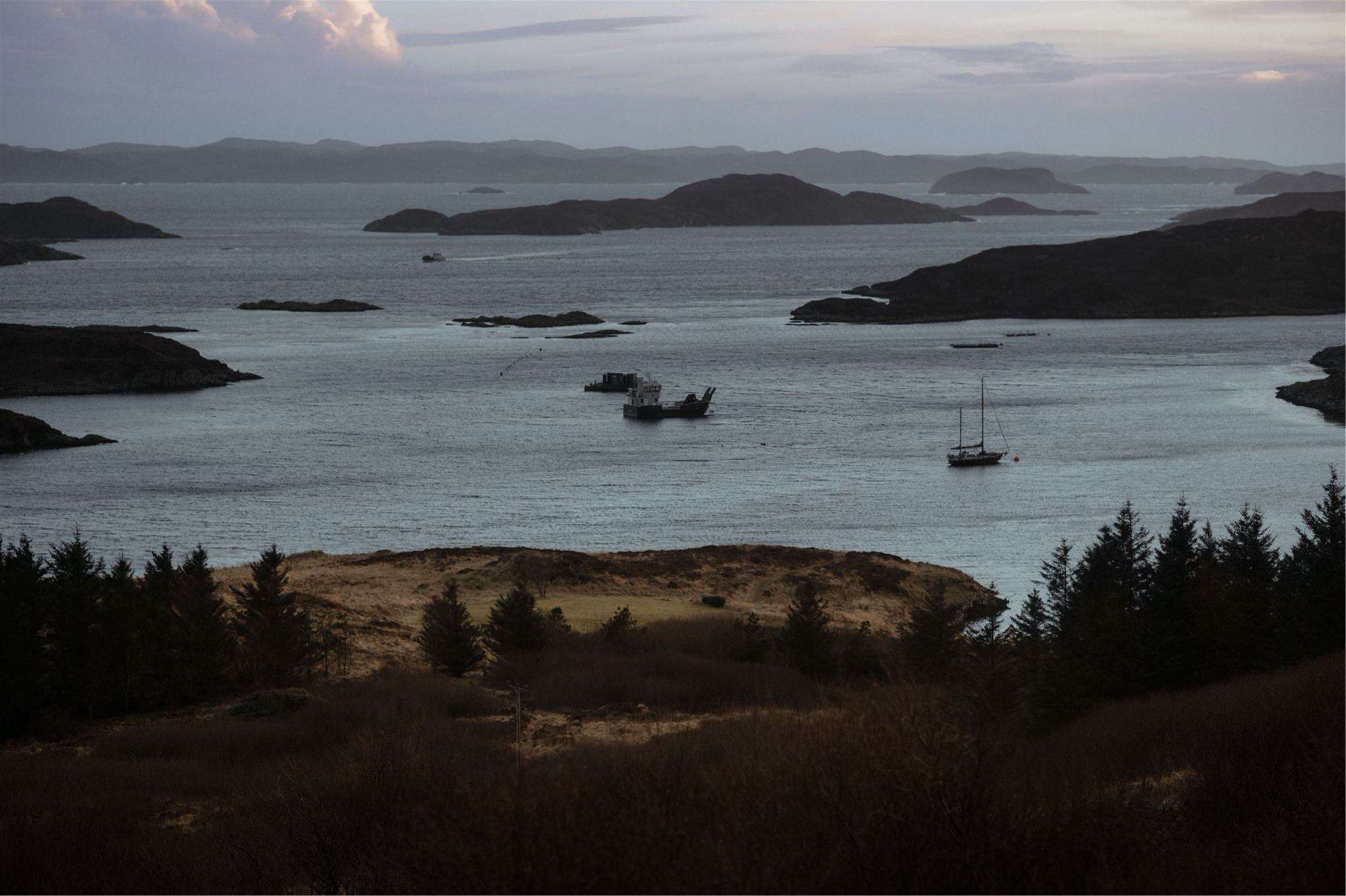 Sea views with boats in Assynt, Scotland - on the North Coast 500