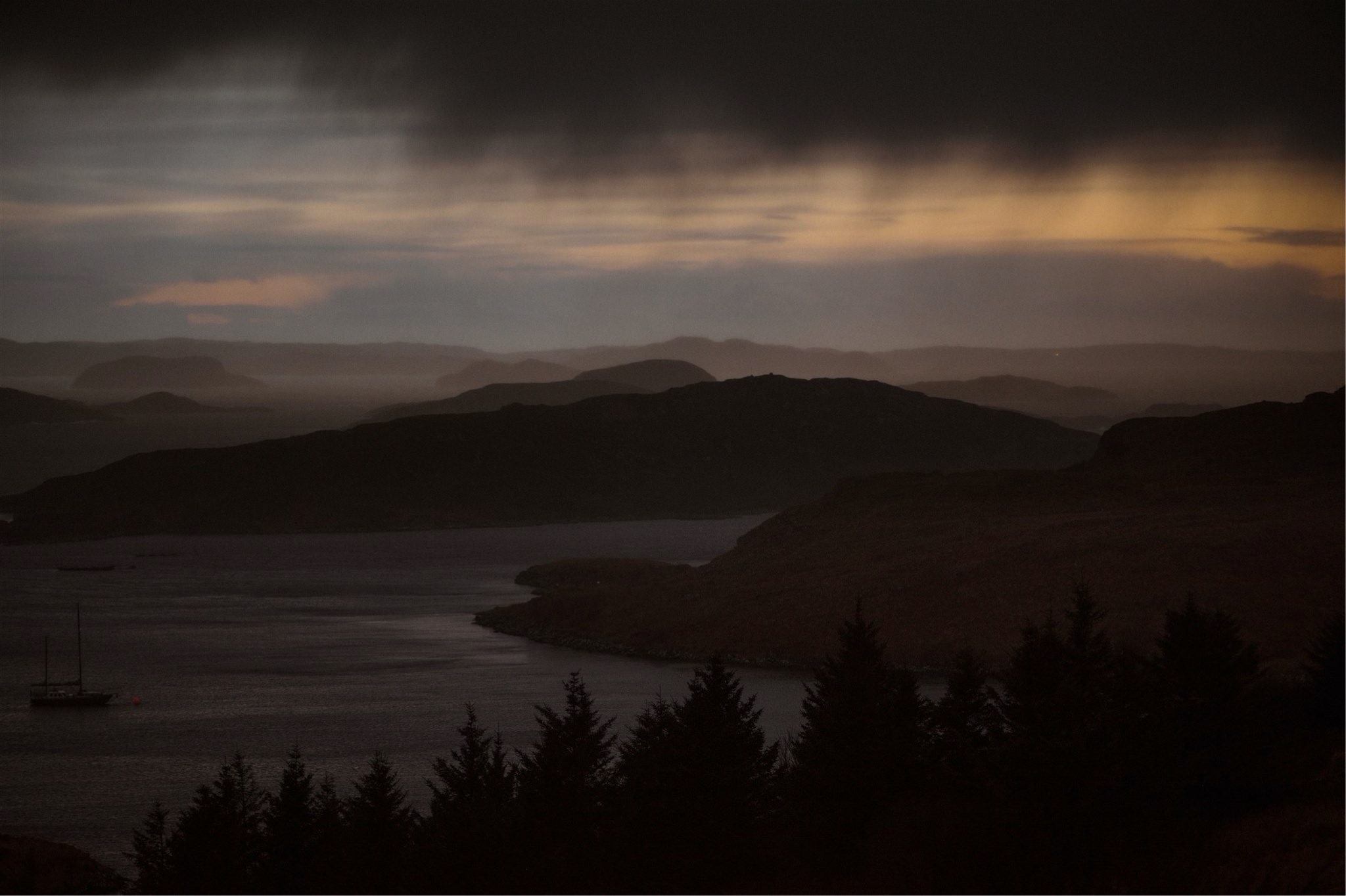 Stormy sunset over the sea in Assynt, Scotland - on the North Coast 500